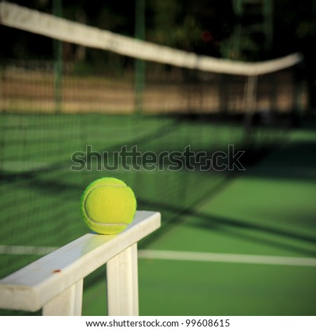 Tennis ball with net background - stock photo