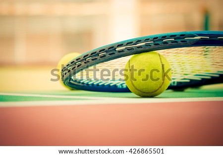 Tennis Ball with Racket on the clay tennis court - stock photo