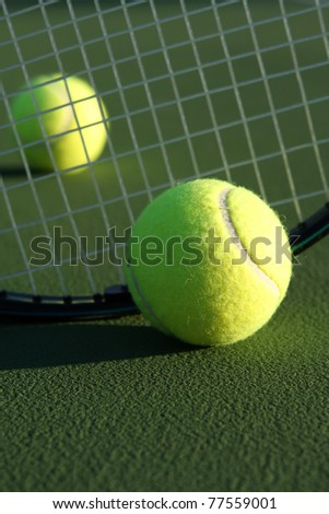 Tennis Balls and a Racket - stock photo