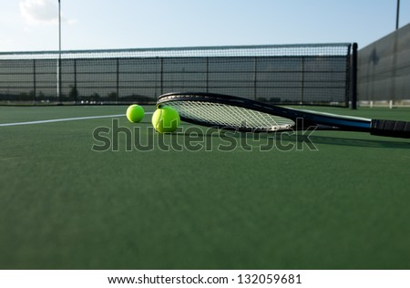 Tennis Balls and a Racket on the Court - stock photo