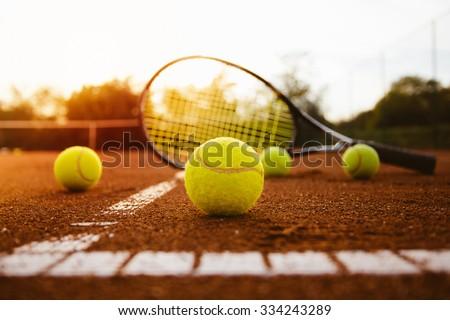 Tennis balls and racket - stock photo