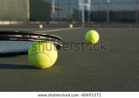 Tennis Balls and Racket on the Court - stock photo