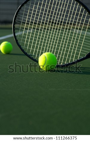 Tennis Balls and Racket on the Court with room for copy - stock photo