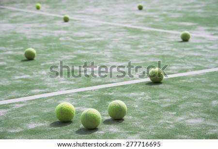 Tennis balls in a tennis field - stock photo