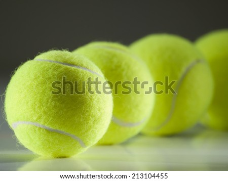 tennis balls in the row ,for tennis,recreation and sport themes - stock photo