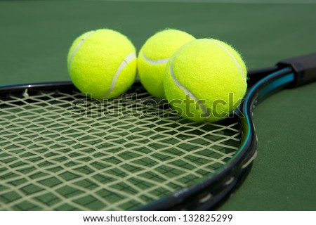 Tennis Balls on a Racket Close Up - stock photo