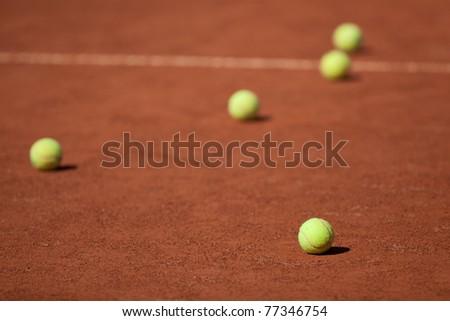 Tennis balls on the court - stock photo