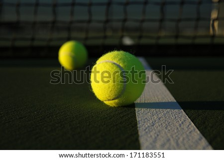Tennis Balls on the Court near the Court Line - stock photo