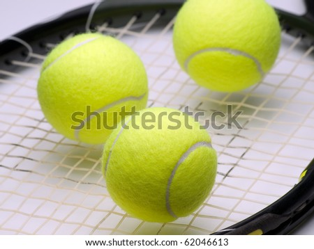 tennis balls on the  racket ,for tennis,recreation and sport themes
