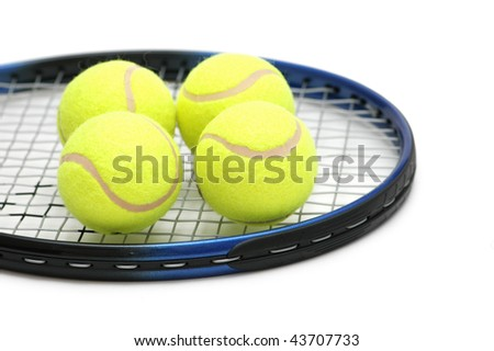 Tennis balls on the  racket - isolated on white - stock photo