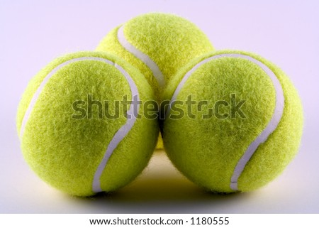 Tennis balls ready for a game - stock photo
