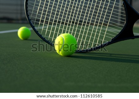 Tennis Balls with a Racket - stock photo