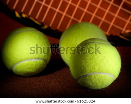 tennis balls with the  racket in the background, low key, for tennis,recreation and sport themes - stock photo