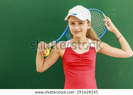 Tennis - beautiful young girl tennis player - stock photo