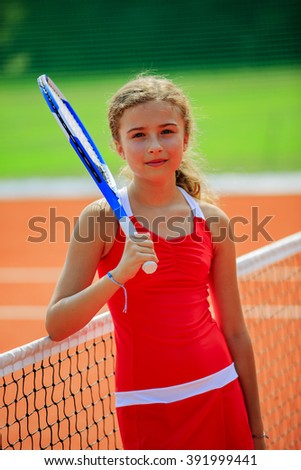 Tennis - beautiful young girl tennis player on the tennis court  - stock photo