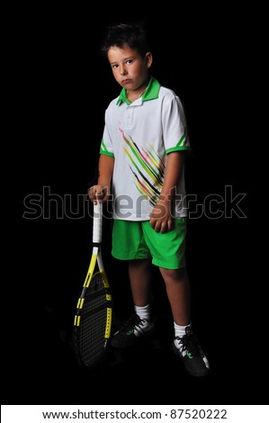 Tennis boy posing isolated in black - stock photo