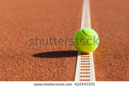 Tennis. Championship. Tennis ball on the clay courts - stock photo