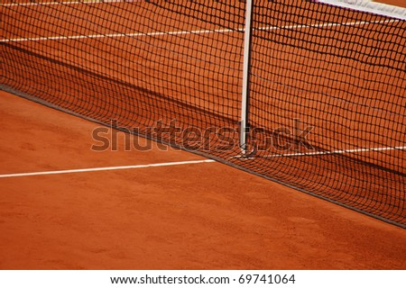 Tennis clay court with net - stock photo
