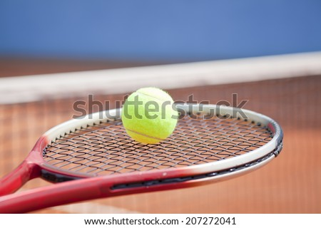 tennis concept on clay court