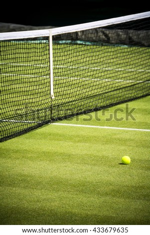 Tennis court and ball on sunny day  - stock photo