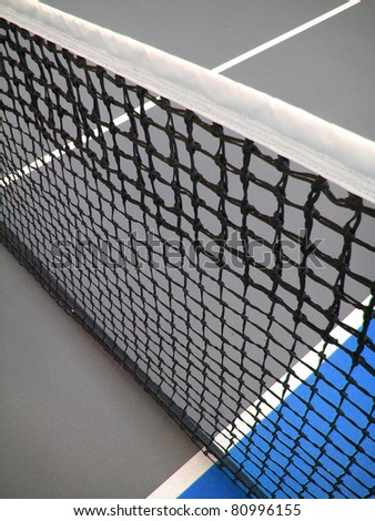 tennis court and net creating diagonal abstract design - stock photo