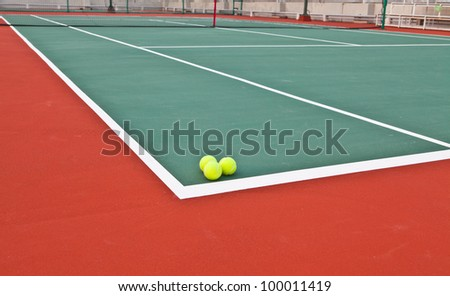 Tennis court at base line with ball - stock photo