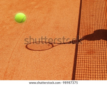 tennis court net and racket shadow with ball 29 - stock photo