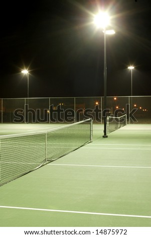 Tennis court on a cool summer evening - stock photo