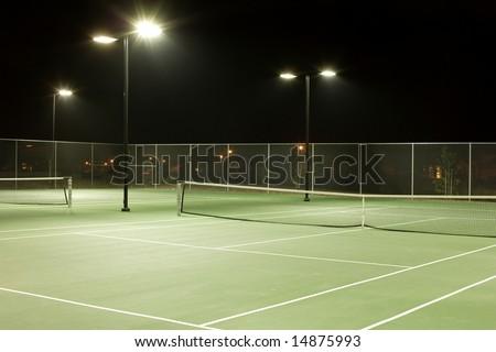 Tennis court on a cool summer evening - stock photo