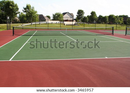 Tennis court playing surface and net - stock photo