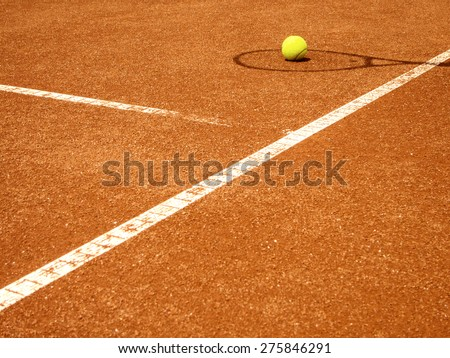 tennis court t-line with racket shadow and ball - stock photo