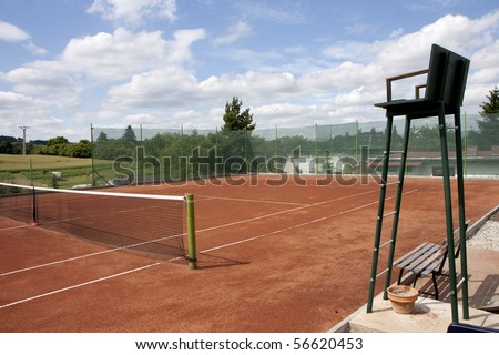 Tennis court - umpire chair and net - stock photo
