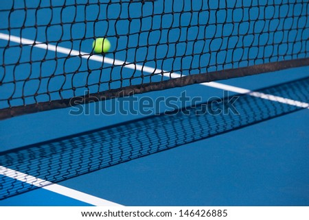 Tennis court with a ball and net closeup in Melbourne, Australia - stock photo