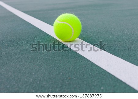 Tennis court with ball closeup