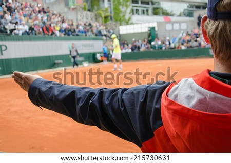 Tennis line umpire calls out after serve - stock photo