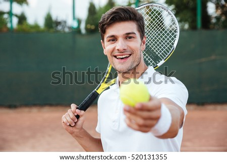 Tennis man with racket giving ball. so happy man