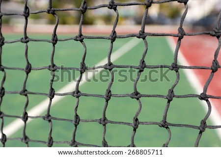 Tennis net, outdoor at empty court. Macro shot. Background