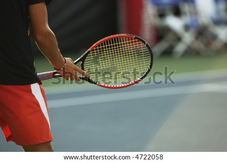 Tennis player and racket between points. - stock photo