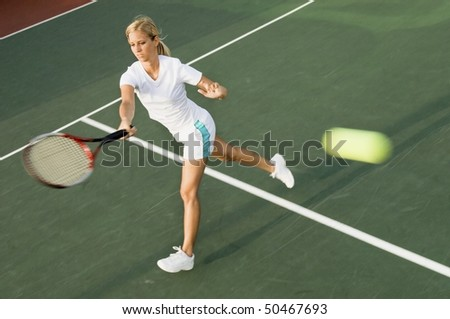 Tennis Player hitting tennis ball with forehand - stock photo