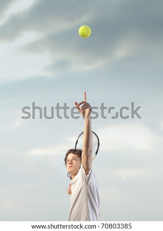 Tennis player in action - stock photo
