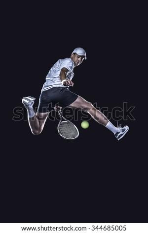Tennis player jumping for the ball from behind isolated on black background - stock photo
