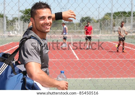 tennis player on the court - stock photo