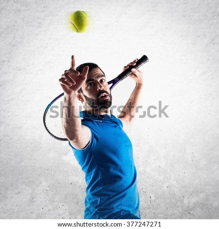 Tennis player over textured background - stock photo