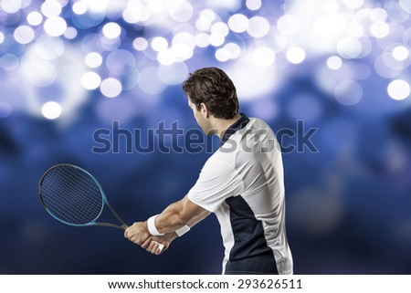 Tennis player playing on blue lights background.
