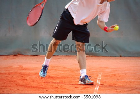Tennis player preparing for service - stock photo