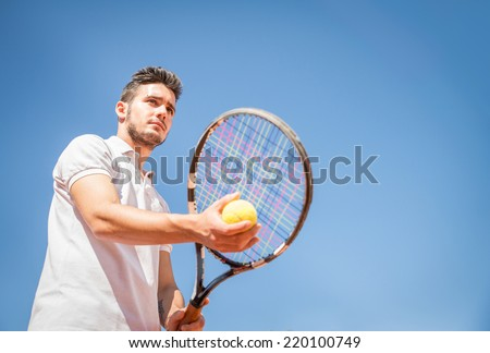 Tennis player ready to play - stock photo