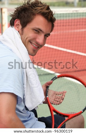 Tennis player resting - stock photo