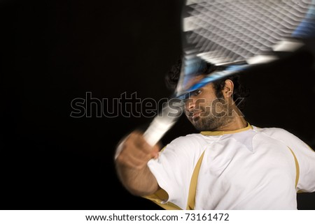 Tennis player shot in the studio. - stock photo
