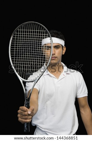 Tennis player showing a tennis racket