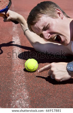 Tennis Player Throws A Dummy Spit Over An Umpires Line Ball Decision - stock photo